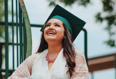 graduate woman wearing a black hat