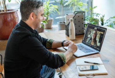 man on conference call laptop